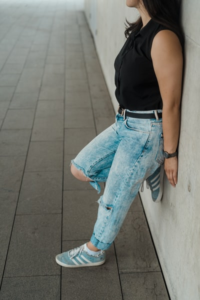 woman in blue denim jeans and black tank top
