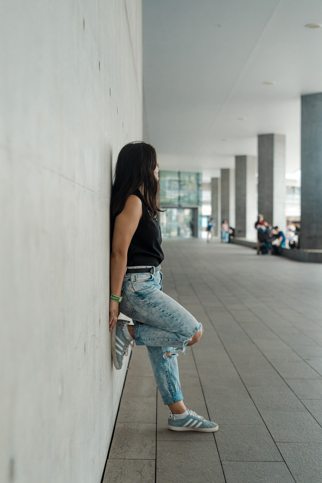 Girl standing on wall near Darling Harbour