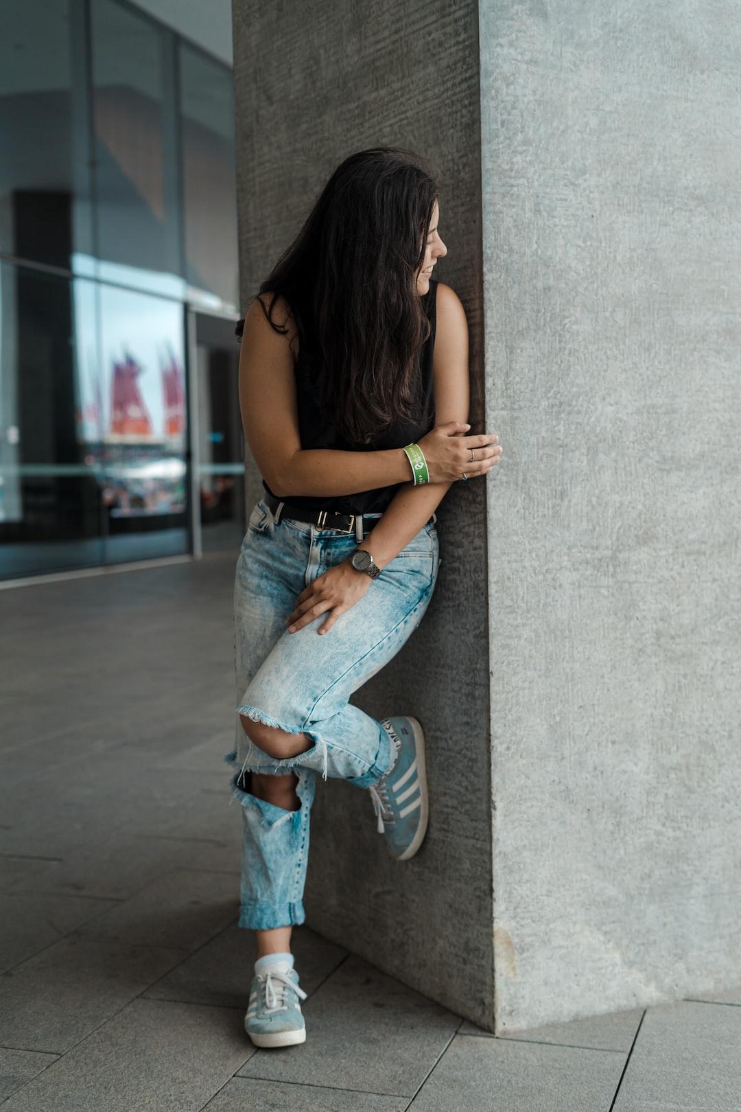 Girl peeking beside the wall