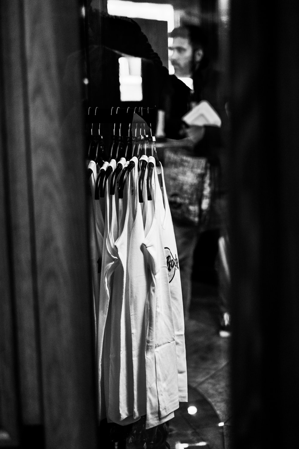 grayscale photo of hanged clothes