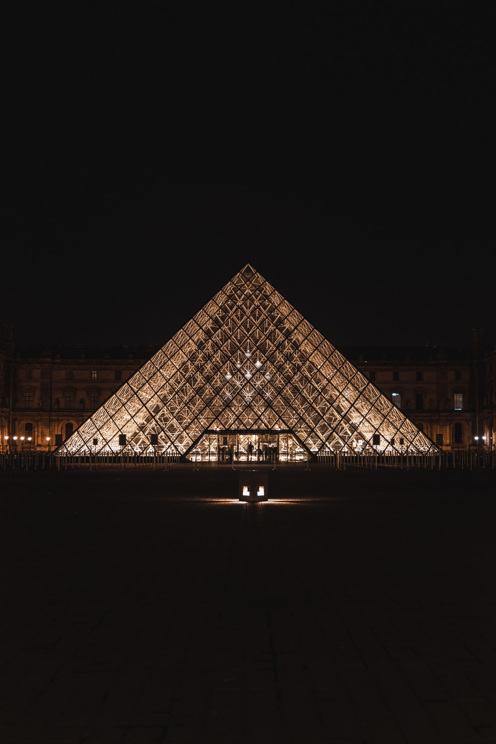 black and white pyramid building during night time