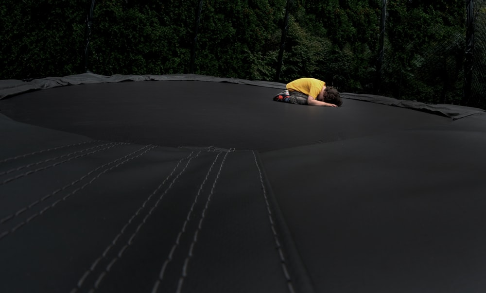 yellow car on black asphalt road during daytime