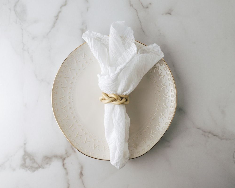 white tissue paper on white round plate