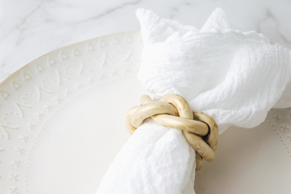 white textile with brown rope