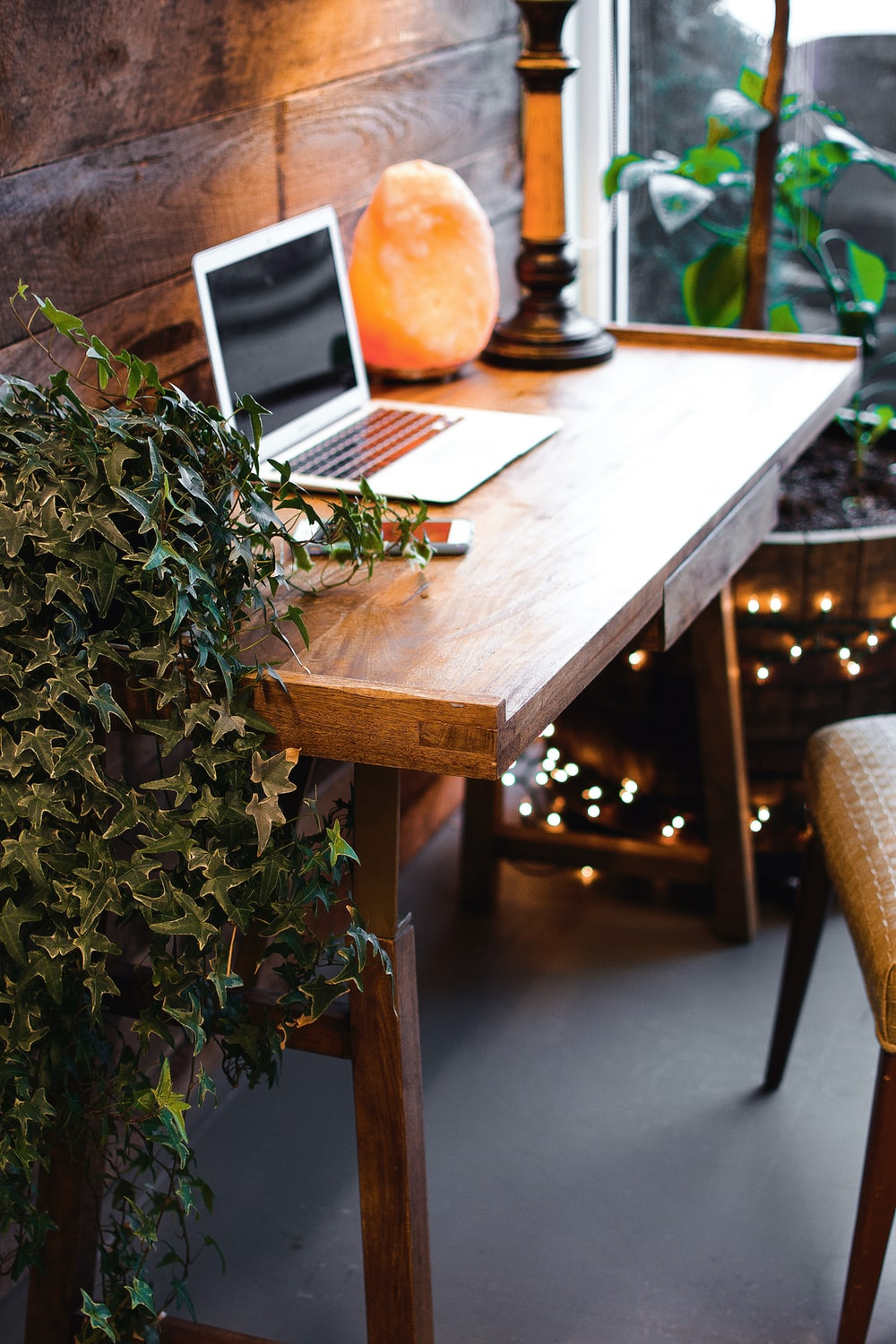silver macbook air on brown wooden table