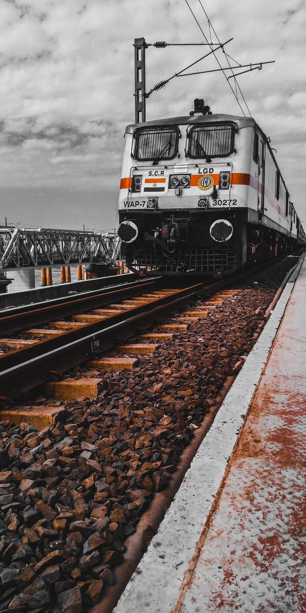 white and black train on rail tracks