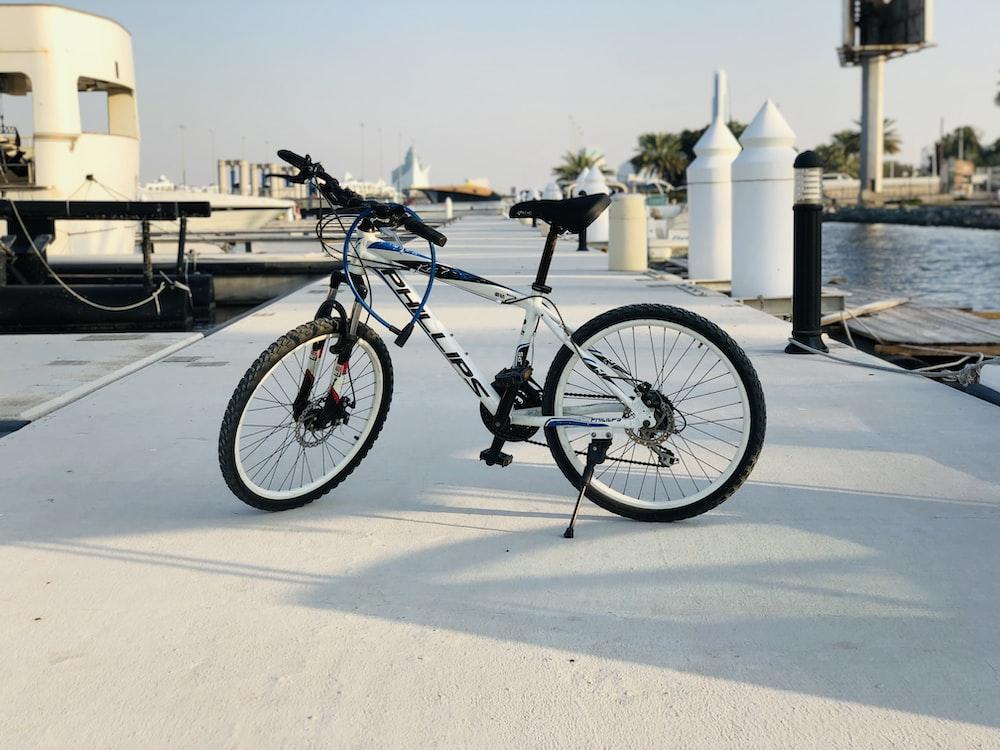 black and white mountain bike on gray concrete floor