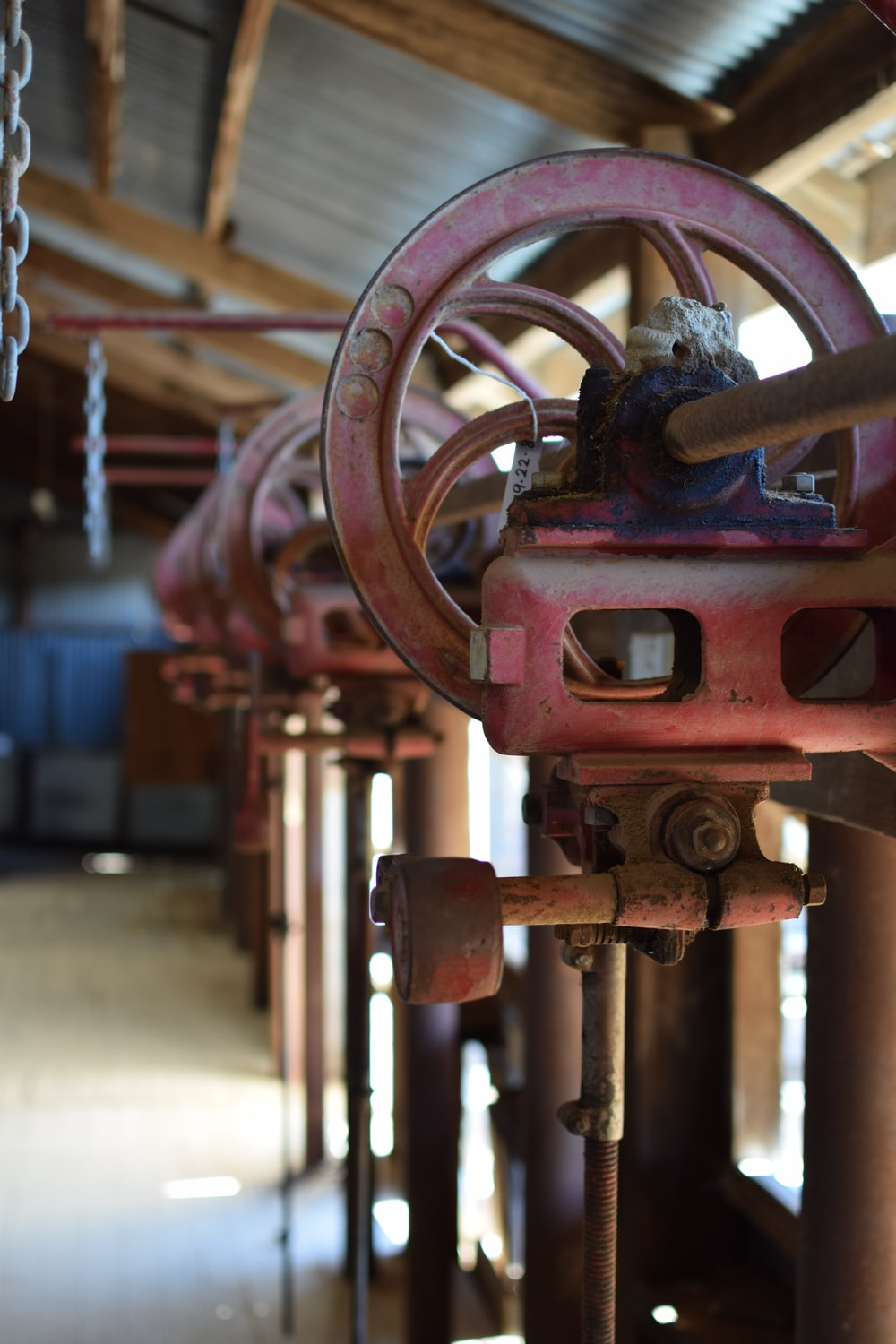 red metal machine in close up photography