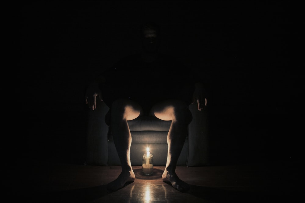 man sitting on chair with light