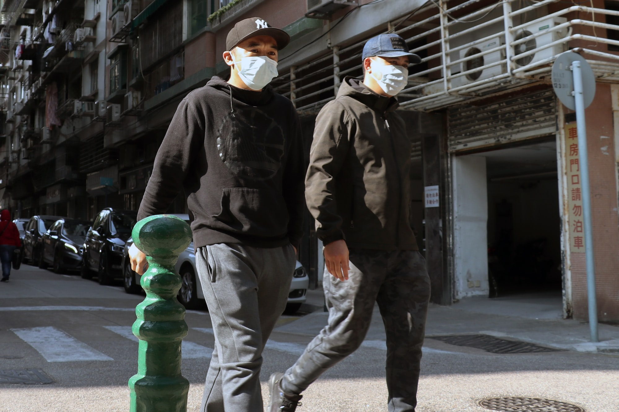 People walk on the street in Macau wearing face masks to protect them to be infected with coronavirus
