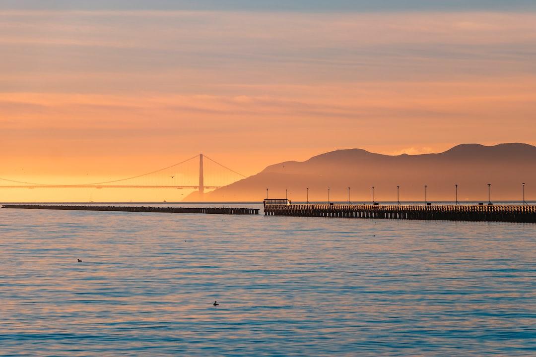 Bridge Over the Sea During Sunset - unsplash