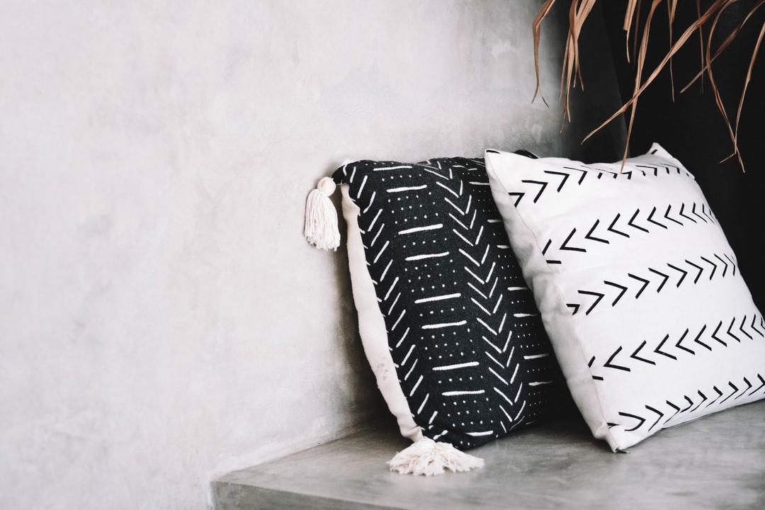 Tribal pillows in a light boheme interior