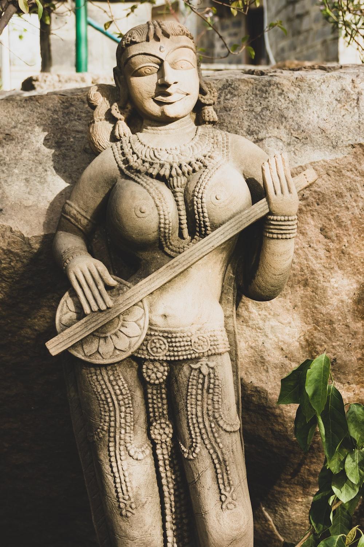gray concrete statue of a woman