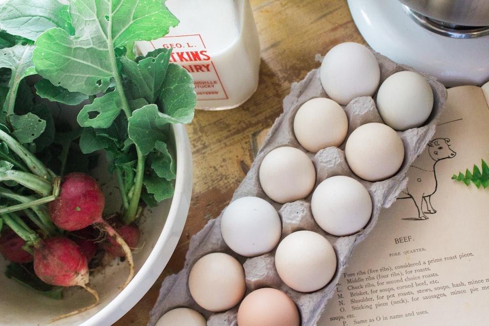white eggs on white ceramic bowl