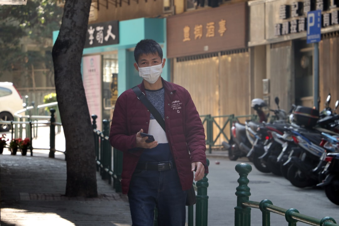 A man walks on the street in Macau, China wearing a protective mask to prevent infection by the coronavirus.
