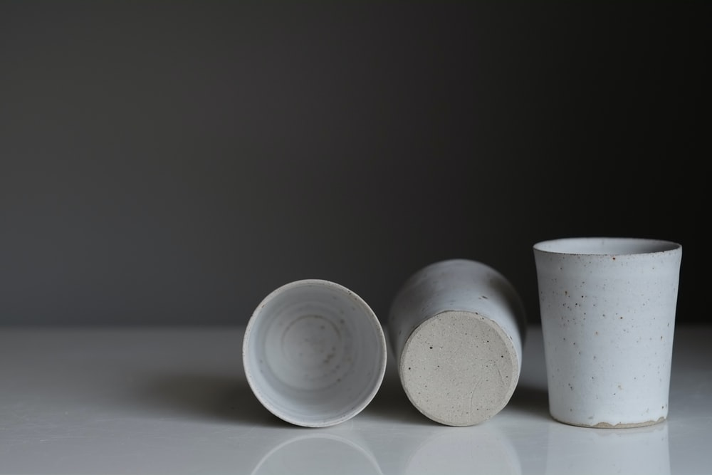 white round plastic containers on white table