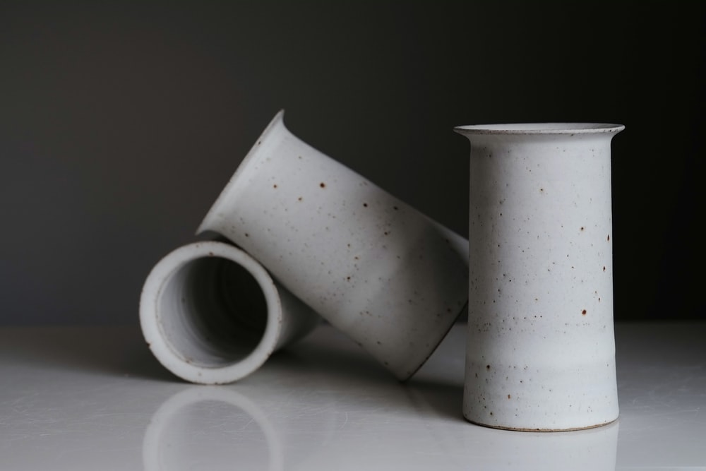 white and black ceramic mugs