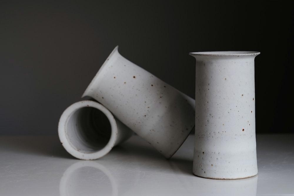 white and black ceramic mugs