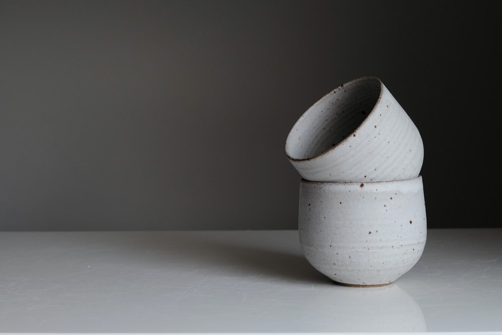 white ceramic vase on white table