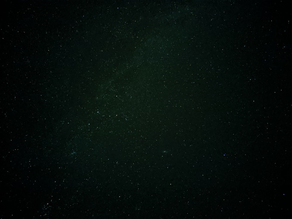 green and black starry night