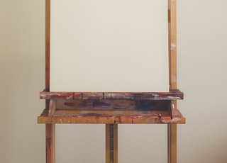 brown wooden table with white wall