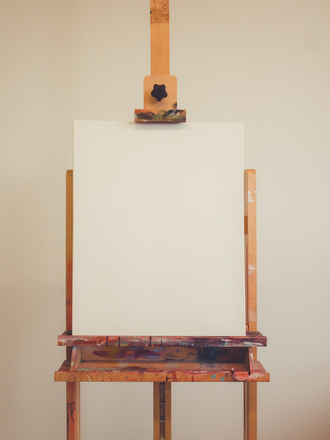 Canvas on an easel in art studio.
