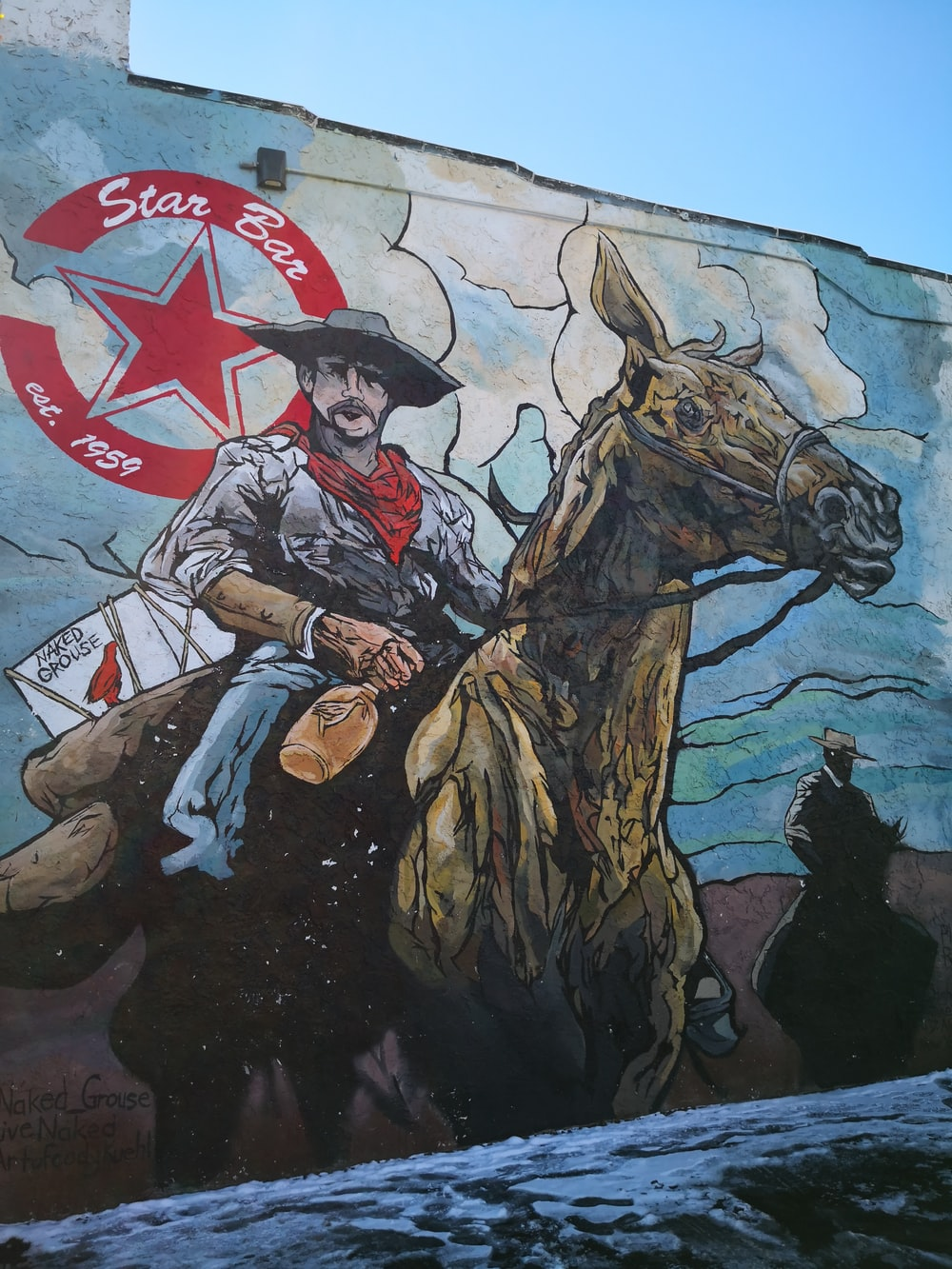 man riding horse holding a flag of america painting