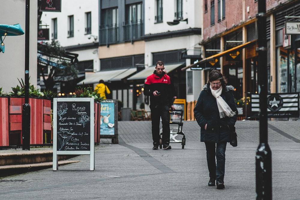 man in black coat standing beside man in black coat