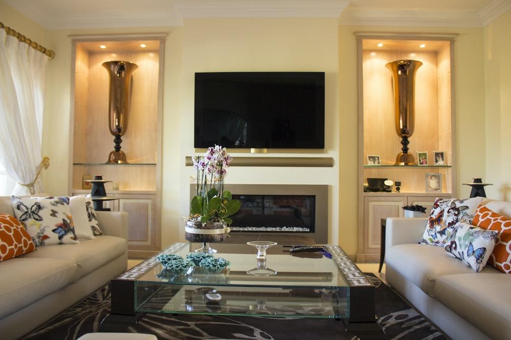 Black Flat Screen Tv On White Wall Photo Free Living Room Image On Unsplash