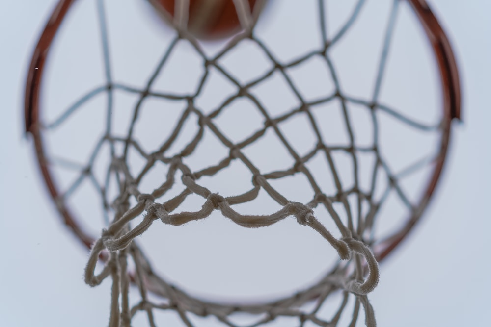 red and black basketball on net