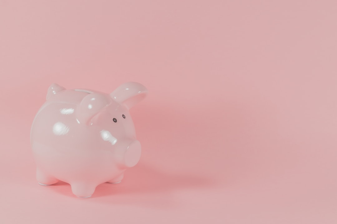 Pink Ceramic Pig Coin Bank - unsplash