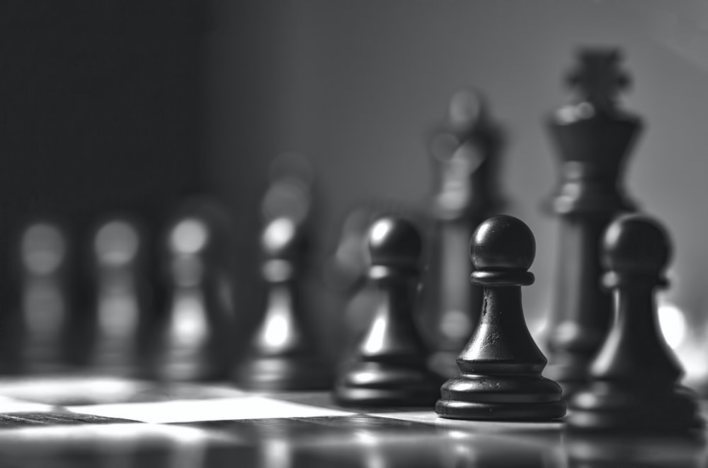 black chess piece on chess board