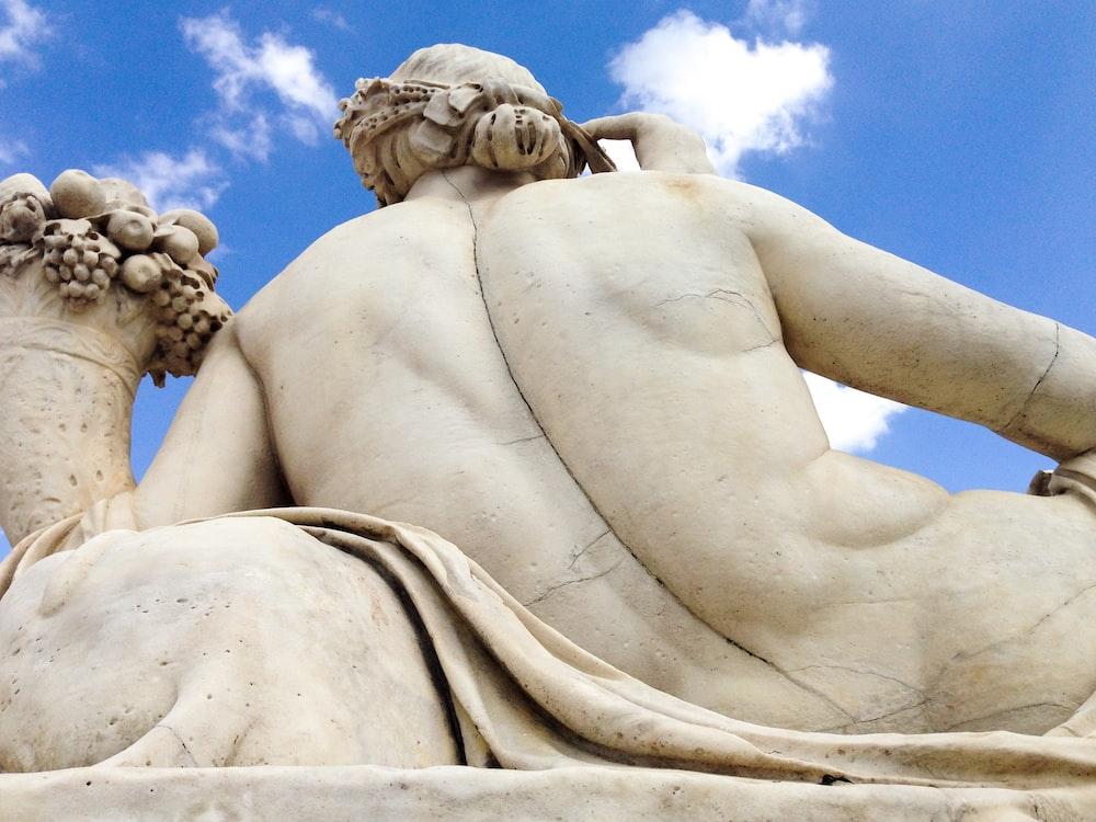angel statue under blue sky during daytime