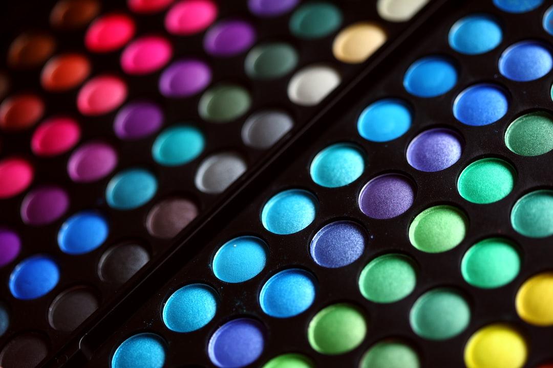 Rainbow palette of pressed powder eye shadow make-up cosmetics