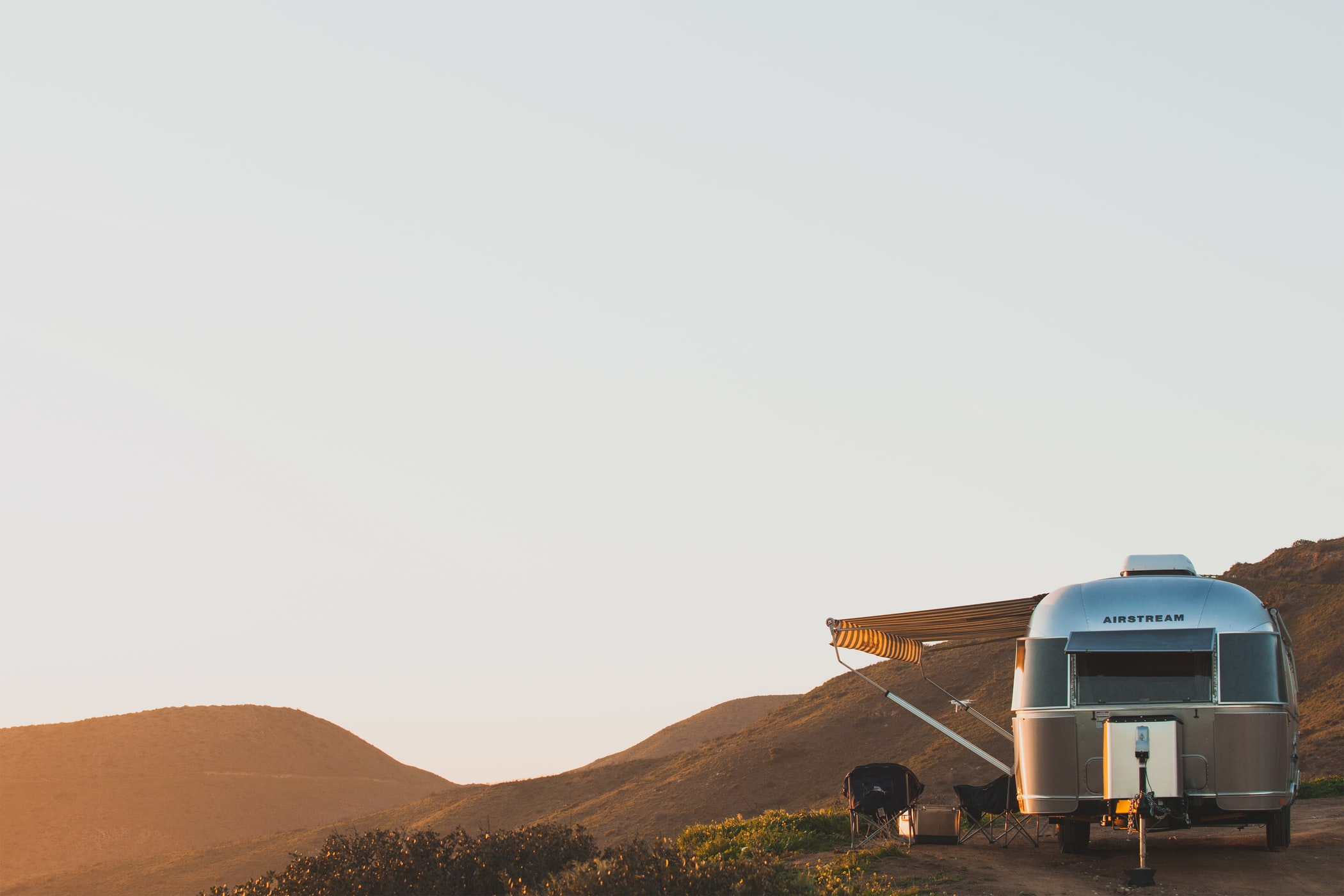 Airstream Travel Trailer on a Mountainside with Big Sky