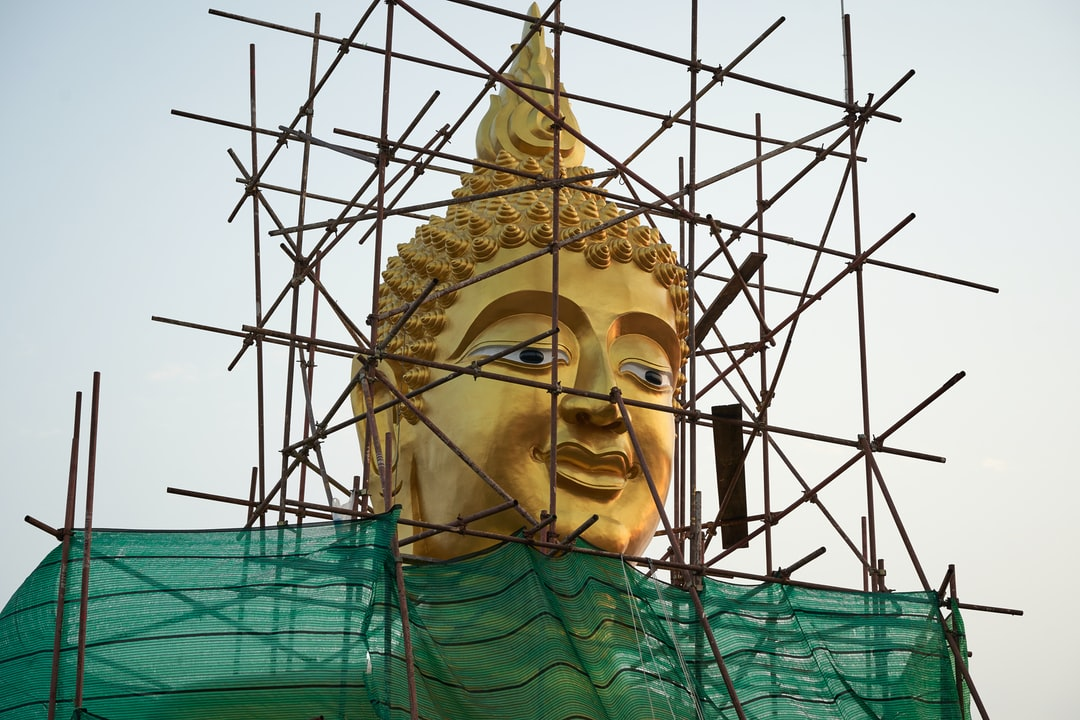 PRISON of the MIND - most people are living in an invisible prison made of their own thoughts and beliefs.  18 metre tall Big Buddha statue at Wat Phra Yai temple is getting a fresh golden coating.