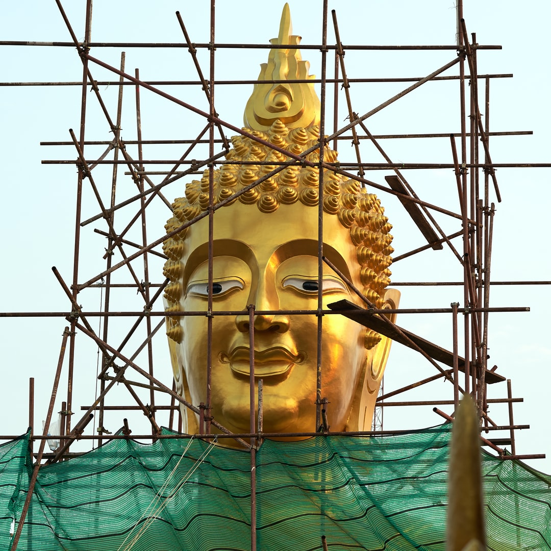 A buddhist temple construction site: the 18 metre tall Big Buddha statue at Wat Phra Yai temple is getting a fresh golden coating.