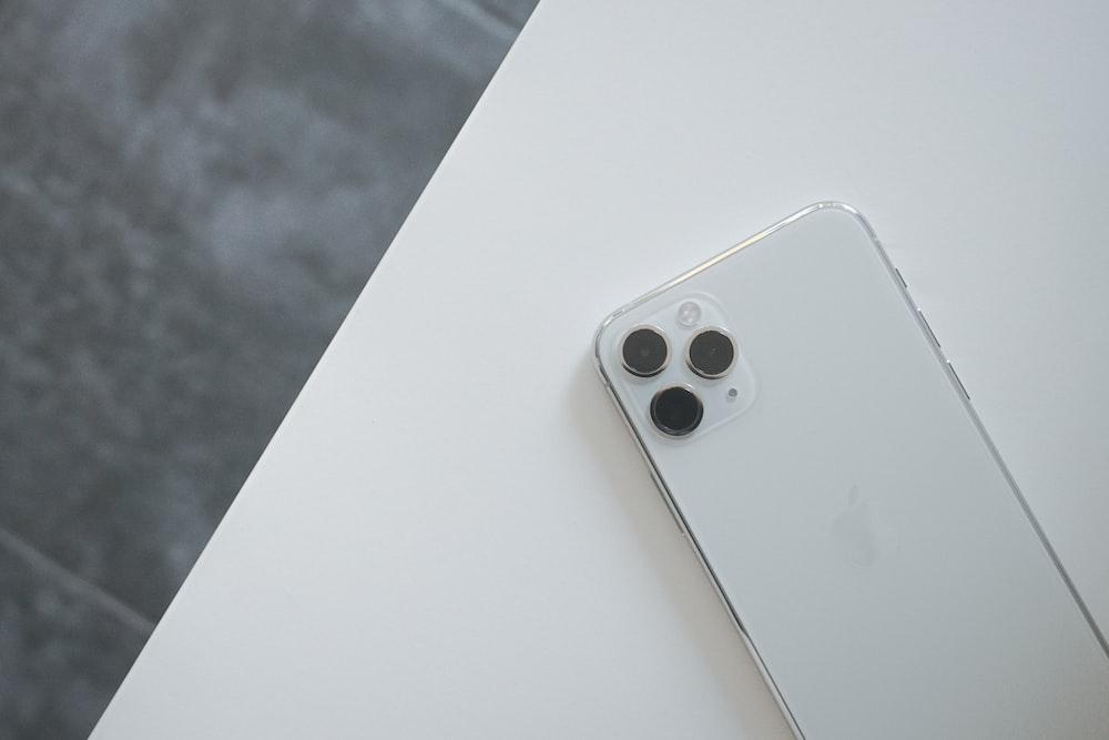 white remote control on white table