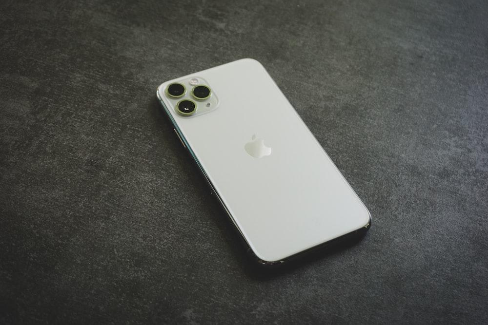 white iphone 4 on black textile