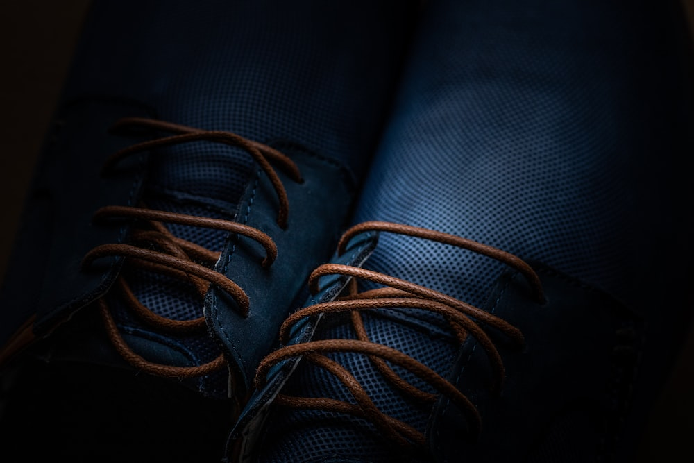 blue and brown rope on black textile