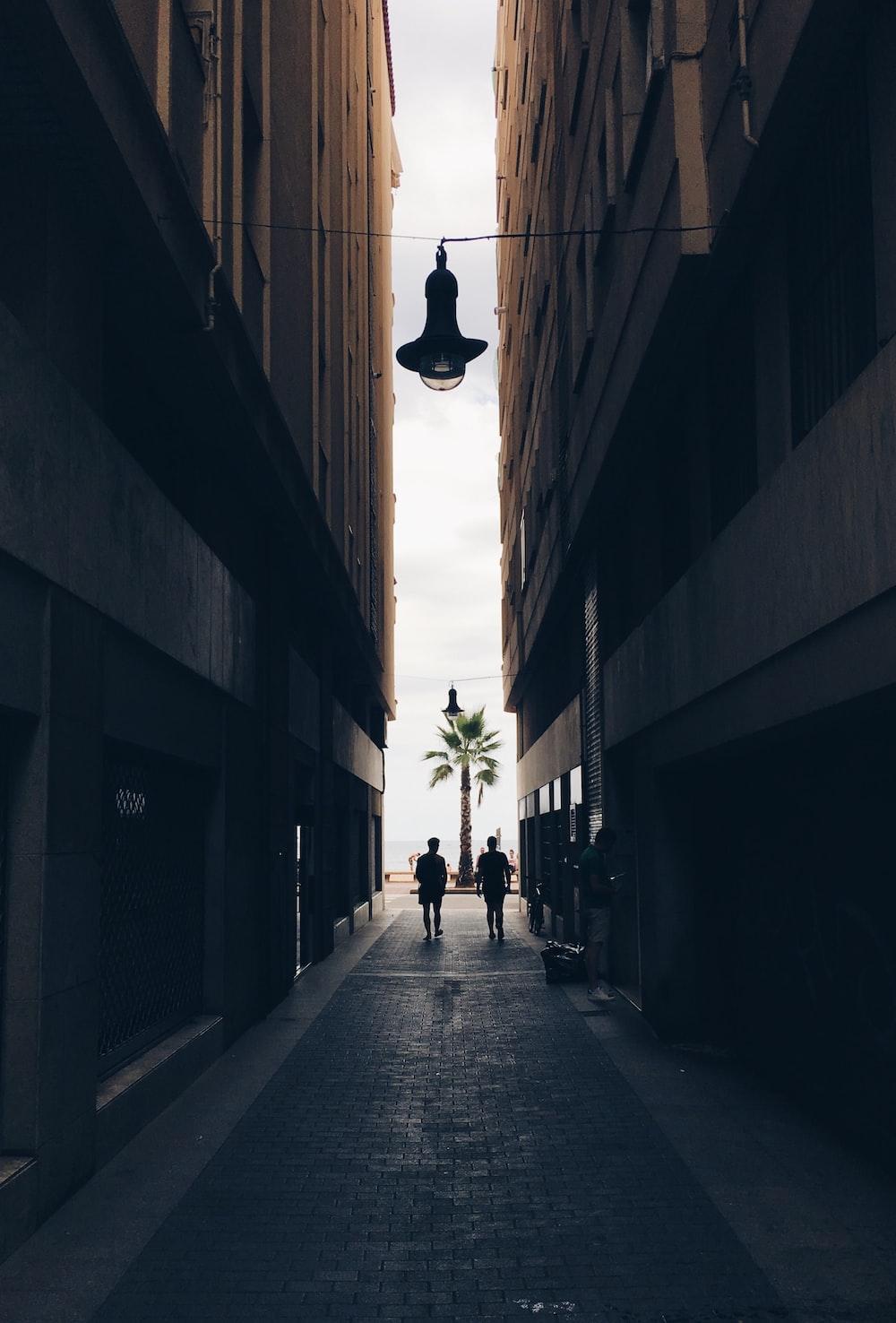2 person walking on hallway