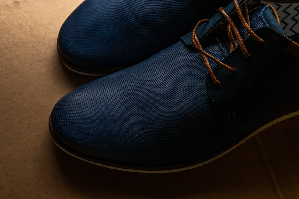 blue and white lace up shoes