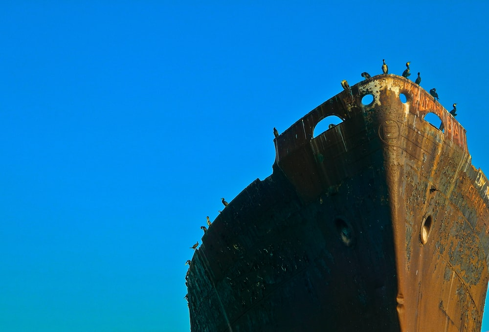 brown ship under blue sky during daytime