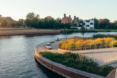 brown concrete bridge over river during daytime belgium teams background