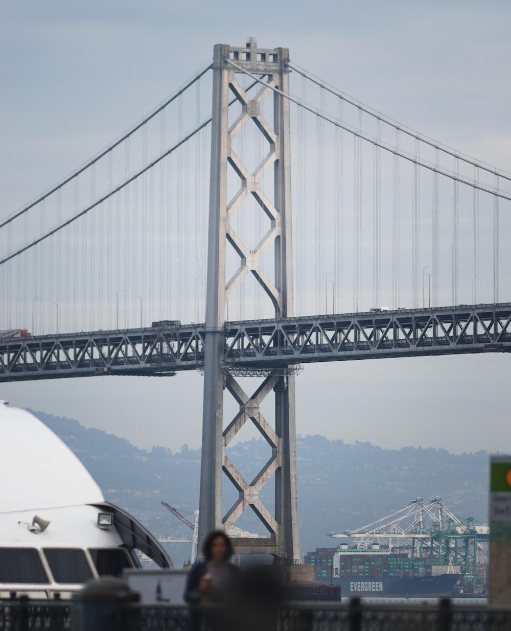 man in black jacket standing near golden gate bridge during daytime