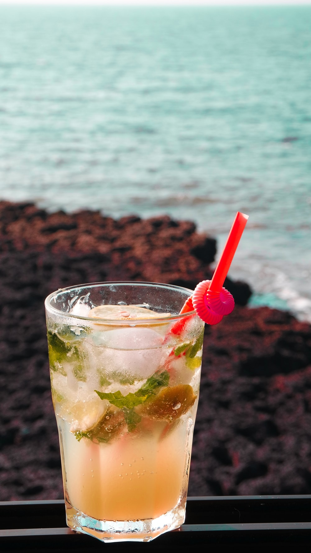 clear drinking glass with red straw