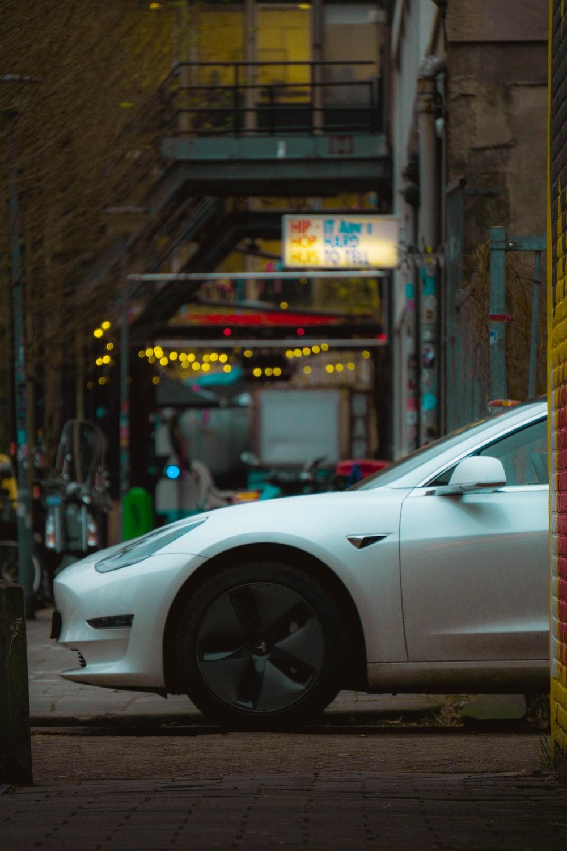 white porsche 911 parked on street during daytime
