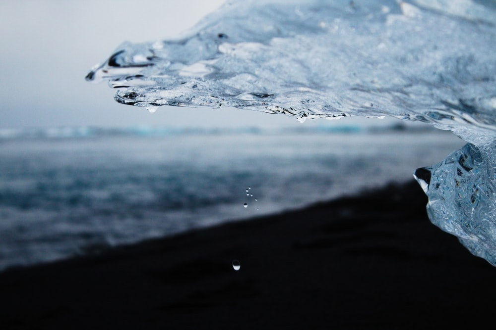 water splash on black sand