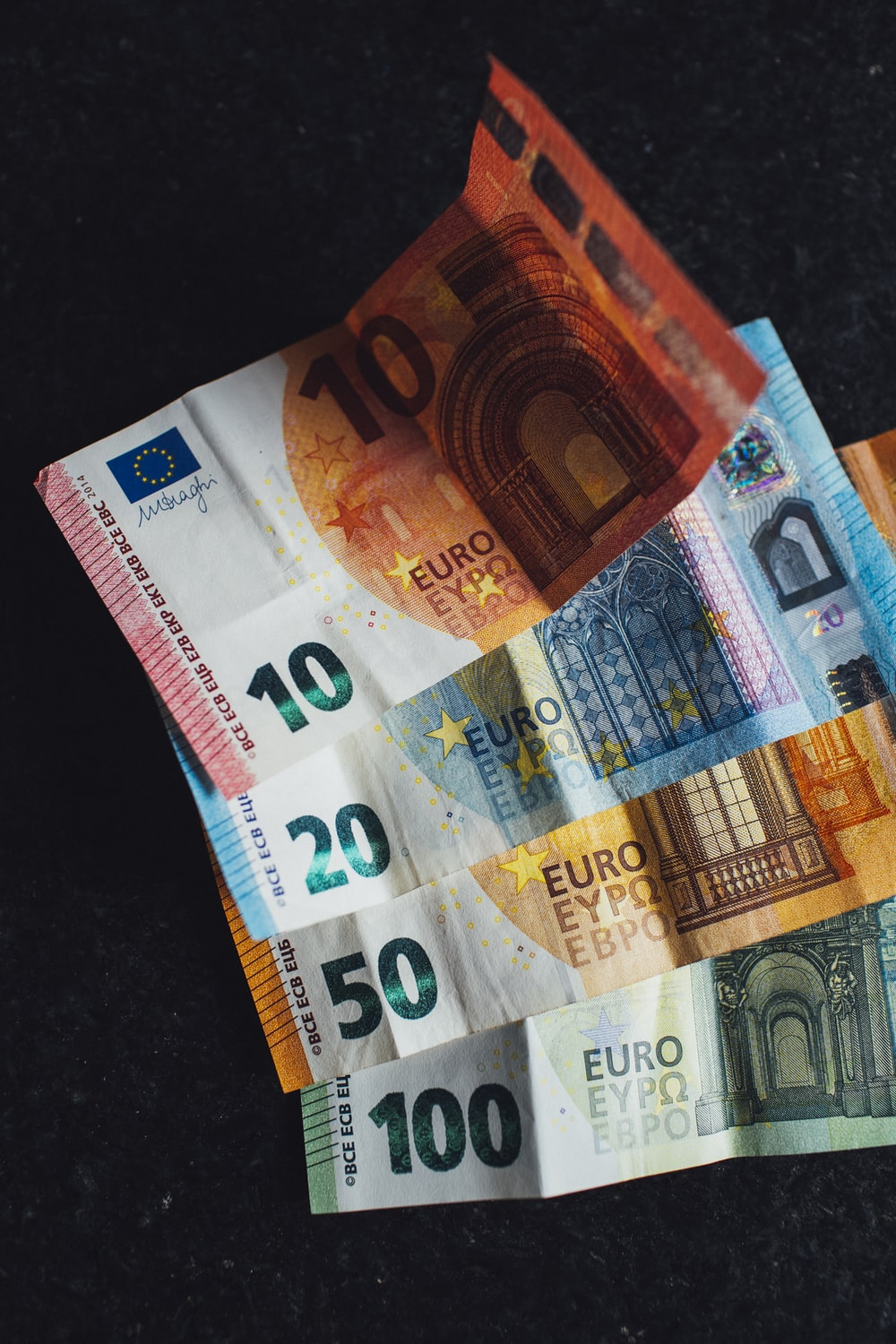 10 euro bill on black textile