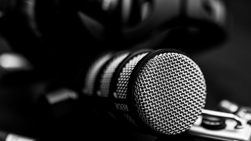 black and white microphone on black and white surface